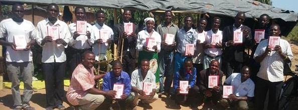Distributing Manna books and Bibles in Malawi