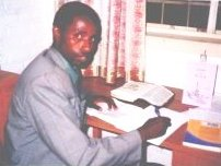 Rwandan Pastor using Bible Commentaries